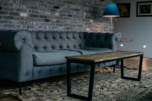 large-grey-sofa-by-brick-wall